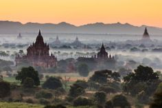 The scenic beauty of the Bagan temples at dawn in Myanmar Bagan, World Best Photos, Mists, Tourism, Sunrise, Places To Visit, Temples, Explore, Photography