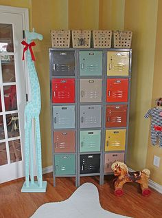 Vintage circus nursery locker unit...Found this vintage locker on a loading dock in Atlanta headed to the dumpster!! Perfect storage for baby clothes. Vintage locker baskets from Etsy for toys. Giraffe makeover...painted a clearance sale Pier 1 giraffe turquoise for a whimsical touch. Found vintage horse at a flea market.
