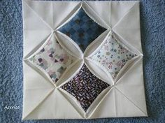 Great tutorial for traditional Cathedral Window technique.  source:  Pincushion