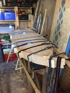 Building my hollow wooden performance fish surfboard. Glueing the rails.