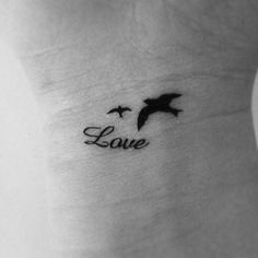 I like the look of the word love... Maybe work it into the branch under the lovebirds I want in my tattoo