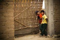 Peruvian boys in a poor, region outside Trujillo.  Humanitarian photography by Alicia Fox.  www.AliciaFoxPhotography.com
