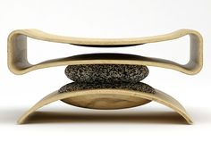 """It Only Looks Precarious    Co-existence is a project by Ryan Jongwoo Choi exploring the """"oneness"""" between man and nature. The beautifully cut ash frames appear to be balancing on an unsteady center point but it's really solid granite. There's something very modern about the execution even though it's supposed to be a nostalgic study."""