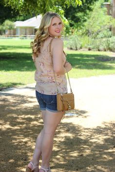 Wearing a floral top and jean shorts on #thatotherhannahblog. Check it out on thatotherhannah.com.