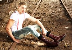 teenage skinhead sitting on railway line