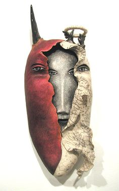 Between Heaven and Hell... ceramic mask by Peggy Bjerkan