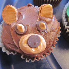 Baylor bear cupcakes for a going away party! Chocolate icing base, use chocolate coated caramel balls cut in half for the ears, chocolate chips for the eyes and nose, and a light brown icing snout!