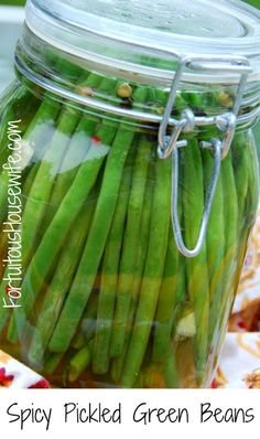Spicy Pickled Green Beans: 1# green beans, trimmed, 3 cups white vinegar, 4 cloves of garlic, thinly sliced, 2 Tbs coarse salt, 1 Tbs black pepper corns, 2 tsp sugar, 2 dried red chilies (or substitute 1/4 - 1/2 tsp red pepper flakes. Adjust peppers to your taste). Directions: Put green beans and garlic in a clean jar. In a saucepan, bring remaining ingredients to a boil. Pour liquid into jar, seal closed and let cool to room temperature before refrigerating.