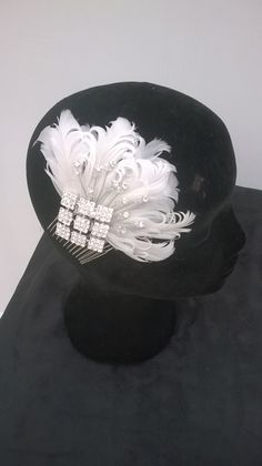 curled feather bridal headpiece on comb for multi positioning