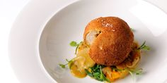This chicken Kiev recipe is sure to become a modern classic. Here, Simon Hulstone demonstrates how to cook chicken kiev in the 21st century, complete with curry and sag aloo