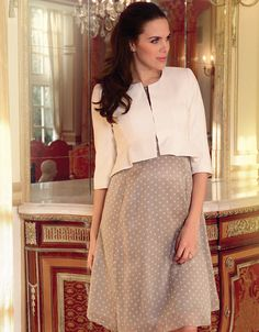 100% silk Elasticated back empire waist Blouson sleeves Keyhole detailing  This luxurious polka dot maternity cocktail dress in pure champagne coloured silk is perfect for the Christmas party season. Draping elegantly over your bump, this flowing knee-length style emphasises your empire line, with a gently elasticated back seam, which adapts to your changing shape. The round neckline is enhanced by an alluring key hole detail at the front. Romantic, delicate blouson sleeves are tapered at…