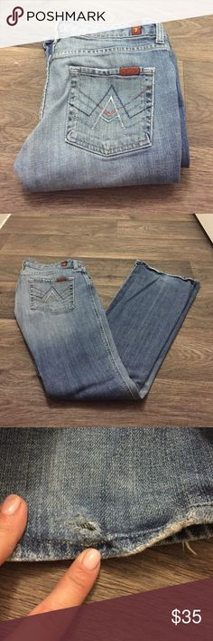 Light washed boot cut jeans Authentic 7 for all ManKind low rise jeans, size 29! Some wear on the bottom of the jeans as seen in photo 3! 7 For All Mankind Jeans Flare & Wide Leg
