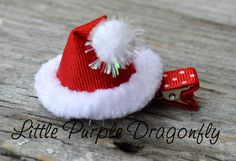 Red Santa Hat Hair Clip Bow by LittlePurpleDragonfl. , via Etsy.