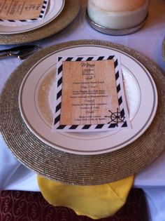 Menus, linen napkins and silver chargers table scape for  nautical baby shower