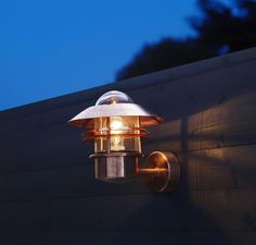 This Scandinavian solid copper outdoor wall light adds a dash of style to the exterior of your home, with the nautical inspired robust frame design...