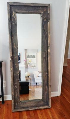 This rustic looking mirror is crafted from solid pine. Carefully hand painted with a grey whitewash paint to enhance the natural wood grain.