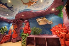 Grab your snorkel mask! The decorative coral in this under-the-sea playroom doubles as arts and crafts storage.