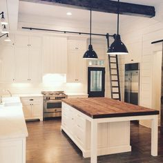 love a library ladder int kitchen; lights on the left, ship lap...  that is not how I would do the island     via @milkandhoneyhome