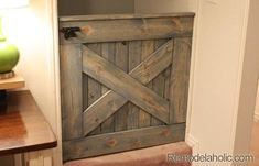 Build your own indoor wooden DIY baby gate! This barn door baby gate adds rustic style while keeping children and pets safe and secured. DIY Barn Door Baby Gate for Stairs Wood Baby Gate, Diy Dog Gate, Baby Gate For Stairs, Barn Door Baby Gate, Diy Baby Gate, Stair Gate, Baby Gates, Pet Gate, Dog Gates