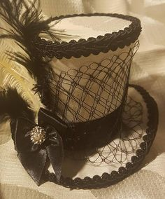 Check out this item in my Etsy shop https://www.etsy.com/nz/listing/556684807/mad-hatter-mini-top-hat-fascinator