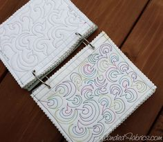 make a book of free motion quilting motifs