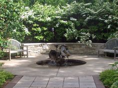 backyard fountains   sunken fountain up close and personal shaped like flowers in a ...
