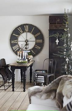 Use of accessories, notice the oversize wall clock on the wall compare to the table size. Amazingly it looks good.http://www.planete-deco.fr/wp-content/uploads/2013/12/SK9.jpg
