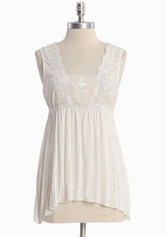 """Subtle Innocence Top 32.99 at shopruche.com. Sweetly demure, this semi-sheer white top features a delicately woven bodice with embroidered details, a sheer back panel, and an elasticized waist for a flattering silhouette.  Self: 100% Viscose, Contrast: 100% Cotton, Imported, 25"""" length from top of shoulder"""