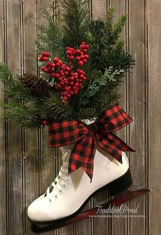 This is an amazing winter decor piece, perfect propped by the fireplace or hang on your door. Its roughly 19 tall, 11.5 across. Filled with holiday greenery, may vary slightly from the one shown as each is custom created by Toadstool Pond.