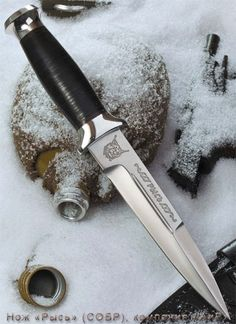 This knife is issued to Moscow SOBR (СОБР), which is a special police force similar to SWAT. It is issued to all SOBR officers. The knife is made of stainless steel and has a lynx head (logo of SOBR) engraved both on the blade and butt.