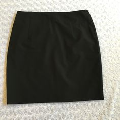 "Black Pencil Skirt This is a Halogen black pencil skirt in EUC. It was my mother inlaw's, and she only wore it a couple times. It is fully lined. Waist is 18"" across when laying flat and length is 21.5"". Materials are posted in the picture above. ⚜Please see my ""reasonable offers"" listing at the top of my page before submitting an offer⚜Thank you Halogen Skirts Mini"