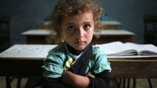 """A Syrian refugee girl sits in a classroom at a Lebanese public school where Syrian students can only attend classes in the afternoon, at Kaitaa village in north Lebanon.  """"These children have seen things that no child, nobody, should ever have to see,"""" UNICEF Canada President and CEO David Morley. Thursday, May 29, 2014"""