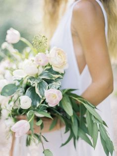 Inspired by the simplicity and laid back feel of Grayton Beach, we kept the bride barefoot, in the most casual of white dresses. We wanted the bouquet to be the ultimate accessory, so while we kept the palette simple, the scale was large. Organic bouquet