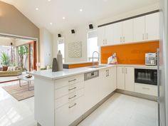 Kitchen with orange splashback