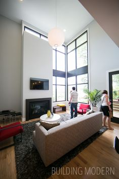 Modern Atlanta Home Tour 2014: Sanders Residence. XMETRICAL LLC architect. 4 bed, 4 bath home. Two story living room with large storefront windows.