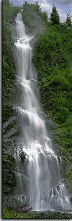 Bridal Veil Falls in Alaska's Keystone Canyon, along the Lowe River. The Richardson Highway runs north from Valdez, through the Keystone Canyon, and tourists are treated to these spectacular falls, along with Horsetail Falls. A popular scenic spot for Alaska travelers.