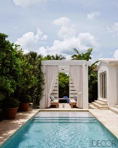 Carlos Aparicio crowned the entry to his lap pool with a classically-inspired draped lounge. Photo by Richard Powers.
