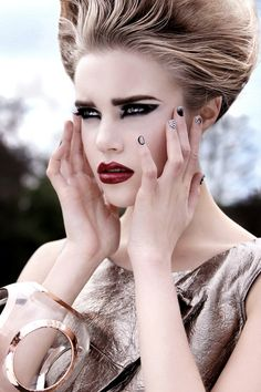 Loving the very pale face against the dramatic eyes and lips.  Not so much the hair