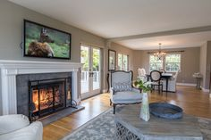 Open living room to dining with beautiful gas fireplace