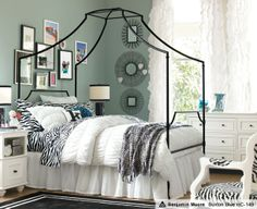 This kinda funky greenish-blue wall color pairs so well with the sophisticated Zebra bedding and black and white accents.