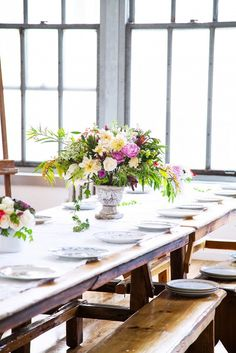 Zio and Sons Gatherings Like These // Party table setting with white china and flower centerpieces.