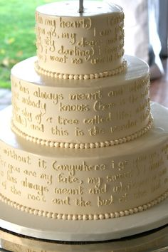 The wedding cake - hand piped poem by ee cummings 'i carry your heart'. done by 'Bella e Dolce', northern Michigan area bakery
