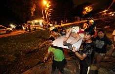 This photo shows a few residents helping to carry a girl that got injured during the blast.