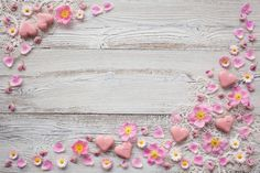 Light wood background with pink flowers, petals, candy in the shape of heart and lace Photo Backgrounds, Colorful Backgrounds, Light Wood Background, Wallpaper Pc, Floral Border, Table Flowers, Background Pictures, Background For Photography, Rose Petals