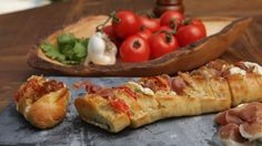 Recipe with video instructions: We stuffed this baguette with your favorite pizza toppings, then grilled it to perfection. Ingredients: 1 stick unsalted butter, 3 garlic cloves, grated, 2 small French baguettes, about 10-12 inches in length, 12 ounces block whole milk mozzarella, 4-5 Campari tomatoes on the vine, 4-5 slices prosciutto, Salt and pepper, to taste