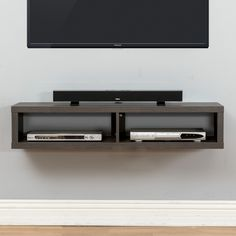 """Features:  -Skyline Walnut finishes.  -Holds 2 audio/video components and a sound bar to compliment a wall mounted television up to 65"""".  -Holds up to 90 Lbs. and comes with mounting hardware for stan"""