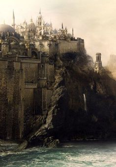 It reminds me of Tashbaan in the horse and his Boy, but the cliff makes me think Cair Paravel