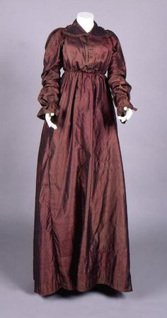 Dress: ca. 1815, hand-stitched changeable silk and linen, with silk-covered wooden buttons. Object Number: 1959.25.4