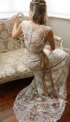 Coffee lace and a plain satin sash make this a beautiful Vintage inspired wedding dress.