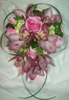 Orchid & Rose Tear Drop Bouquet - Tear Drop Bouquet of Cymbidium Orchids, Roses, Hydrangea, Ivy, Lily grass, and Aspidistra ribbon. $165.00